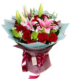 Say I Love You with this perfect selection of 16 red roses and 2 pink lilies.