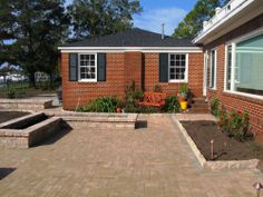 Raised beds define the living space of this new patio, add seating, and reduce back strain for a client who wants to garden in retirement. When planted this spring, they'll add an attractive foreground to a water view from the house.