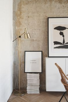 The long white dresser at the end of the living room pops against the concrete…