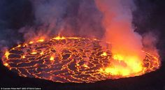 Sizzling: Molten rock cools and forms plates on the surface of the worlds largest lava lake at Nyiragongo in the Democratic Republic of Congo