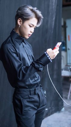 How can man be so sexy just standing and charging  phone