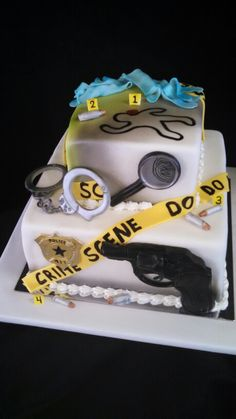 Police/CSI themed cake by christinascakery.com  handcuffs, police badge, pistol, magnifying glass