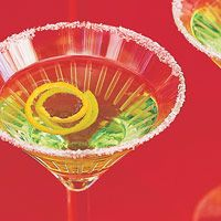 Apple Martini  3 cups vodka or gin  3/4 cup frozen apple juice concentrate, thawed  1/3 cup dry vermouth  Ice cubes  Fresh orange peel twists (optional)  1 orange, cut into wedges rub rim of glass then sugar the rim