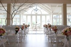 The ceremony was held in the Conservatory Room of the pavilion building at Hopewood Country House.
