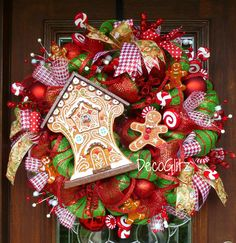 This 28 Baravian Ginegerbread House Christmas Wreath Is Adorned With Gingerbread Men And Red White