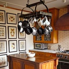 The owners of this kitchen built new cabinet boxes and restored the original gumwood fronts. | Photo: Courtesy of Deborah Hall and Don Post | thisoldhouse.com