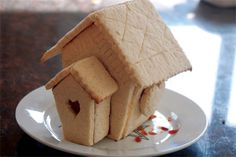 Printable pattern, recipe and instructions for making a sugar-cookie house that can be decorated by kids.