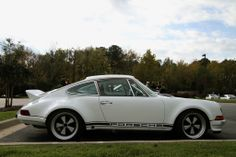 Porsche 911. Dont like white but navy blue would be nice