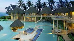 No Soneva Fushi Resort, nas Maldivas, a piscina é cortada por uma área de estar