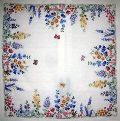 "Spring tea cloth embroidered by Margaret Cobleigh. It's a kit from Anchor, entitled ""Spring."""