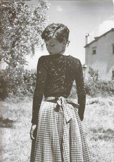 Audrey Hepburn-slim silhouette above, fuller skirt below