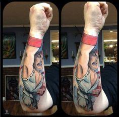 Hadouken! This badass tattoo ofStreet Fighter's Ryu was done by Schwab. #InkedMagazine #StreetFighter #Ryu #Hadouken #tattoo #tattoos #Inked #ink