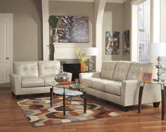 التناغم الثلاثي في الألوان البرتقالي والبني والكنب الأبيض الجلد يعني راحة قصوى للعين والروح  #Ashley #home #furniture #new