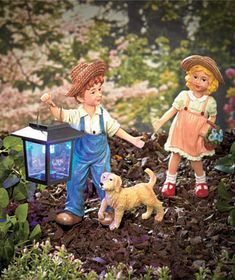 Give your garden a youthful touch with the three childhood friends in this 3-Pc. Solar Garden Statue Set. Each piece is crafted with exquisite details that give it realistic appeal. A dog walks next to the boy as he leads the way with a solar-powered lan