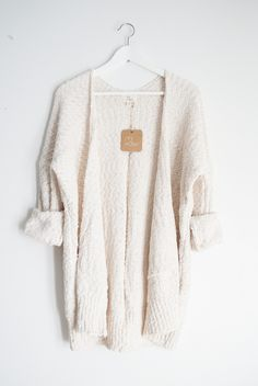 """- Super soft sweater knitted cardigan - Available in one size only - Boxy silhouette - Best fits S/M for a loose/slouchy fit - Measures approx. 35"""" in length - 70% Acrylic 27% Nylon 3% Spandex - Impor"""