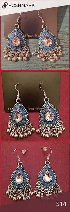 "30% OFF BUNDLES Teal Blue Chandelier Earrings Just so adorable! These earrings will complete your boho look or anytime really. Teardrop shapes with silver tone little balls hanging. The body is an enamel finish & there are tiny faux pearls surrounding. The center has a clear stone. Length is 2.25"" Fish hooks with backs. NWT Excellent condition. Bundle another item with this & get 30% OFF! boutique Jewelry"