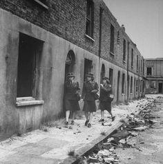 1943 London Blitz - American WACs    London's East End Blitz 1943 - American WACs (Women's Army Corps) walk pass bombed-out homes.