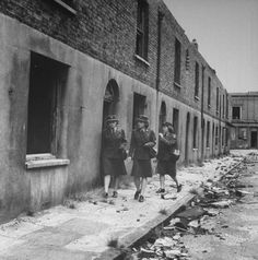 1943 London Blitz - American WACs    London's East End Blitz 1943 - American WACs (Women's Army Corps) walk pass bombed-out homes.
