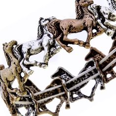 Galloping Horses Stretchable Bracelet Rustic Hammered Stretch Bracelet Beautiful Western Design Stretchable to fit most sizes Antiqued & Charming Design in Gold/Silver colors Any horse lover will be thrilled to wear this bracelet! Jewelry Bracelets
