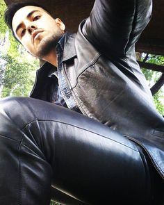 Young beautiful men in leather