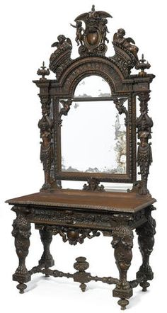 A Continental Renaissance Revival carved walnut console and mirror late 19th century