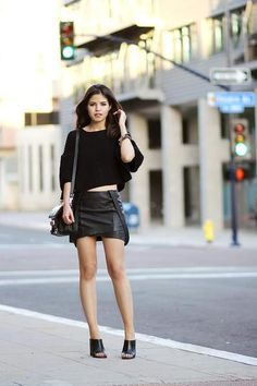 30 ways to wear a black leather skirt - black sweater + mules // Fake Leather