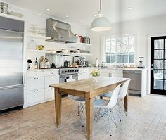farm house table, modern chairs, enamel light fixtures