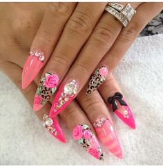 3D roses, pink stripes, and animal print Nail art