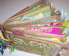 Brown paper bag mini scrapbooks!!  What a great craft idea to do with the little one!