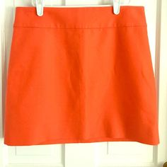 """J. Crew Factory Bright Mini Skirt Factory double-serge cotton mini in """"Bright Persimmon"""". One tiny snag on back near zipper (shown in picture), otherwise great condition! J.Crew Factory Skirts Mini"""