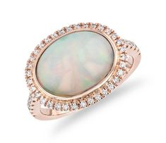 East-West Oval Opal Ring with Diamond Halo and Sidestones in Rose Gold by Blue Nile. Opal Rings, Gold Rings, Gemstone Rings, Halo Diamond, Diamond Rings, Salon Names, Beauty Salon Design, Blue Nile, 18k Rose Gold