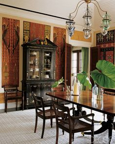 Antique Indonesian ikats are set into the dining room walls of this Vero Beach, Florida, home.