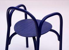 Samuel Wilkinson creates minimal chair using steam-bent wood chair