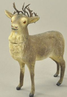 GERMAN REINDEER CANDY CONTAINER for auction. A wonderful composition figure with fur like flocking, brown glass eyes and metal antlers, head removes for candy retrieval, standing in majestic pose. Antique Christmas, Christmas Deer, Father Christmas, Christmas Items, Merry Christmas, Vintage Candy, Vintage Santas, Vintage Holiday, Santa And His Reindeer