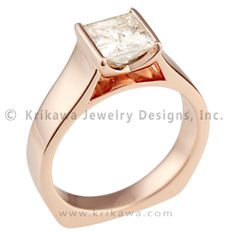 Modern Cathedral Engagement Ring in Rose Gold - This modern engagement ring's center stone is boldly raised above the band in a cathedral style. The clean lines and bold styling create a striking ring. The bezel setting has a deep V cutout and comes to a dramatic point that can be viewed through the cathedral window. 5 mm wide.   - This is a Modern Cathedral Engagement Ring in rose gold featuring a white princess cut diamond center stone.