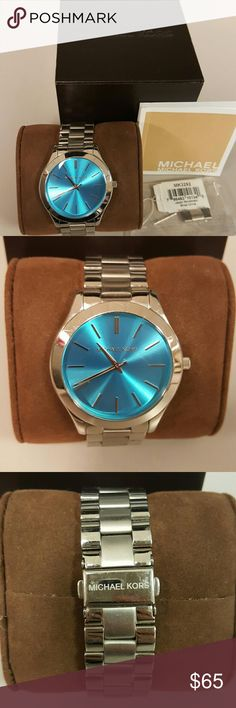 Michael Kors Ladies watch Michael Kors men's style watch. Silver tone with turquoise blue face. Does need battery. No links have been taken out. Comes with original box, and extra link. Has minor scratches and listed as is condition. Michael Kors Accessories Watches