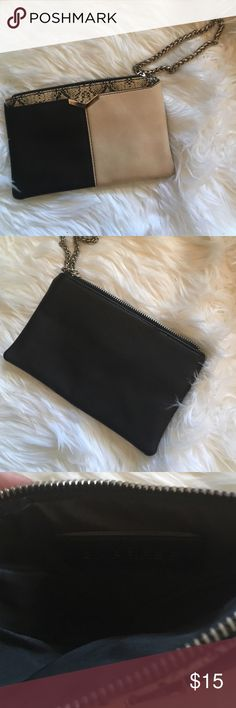 Express || Black and Cream Wristlet So stylish ! Heavy and study chain for wrist . Black and cream modern look. Inside is superb ! Express Bags Clutches & Wristlets