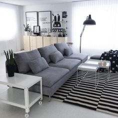 Beautiful house of @svartvitrandig with Ikea 'Söderhamn' sofa, 'PS' coffeetable, 'Stockholm' rug and in the back Ikea 'Ivar' storage unit