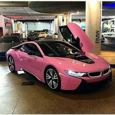 The BMW was unveiled at the Frankfurt Motor Show in 2013 and is a plug in hybrid sports car. The combines a turbo charged motor with a large electric engine and the car has some impressive performance figures. Bmw I8, Carros Toyota, Carros Bmw, Mustang Wheels, Car Wheels, Dream Cars, Rosa Bmw, Fancy Cars, Cool Cars