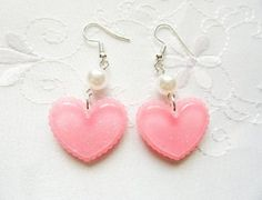 These pretty earrings feature glittery pink hearts with a pearl bead. Heart charms are made from acrylic resin. They are securely attached to silver plated surgical steel jewelry findings. Nickel free for sensitive ears. Kawaii Jewelry, Pink Jewelry, Cute Jewelry, Diamond Jewelry, Diamond Earrings, Pink Earrings, Cute Earrings, Heart Earrings, Dangle Earrings