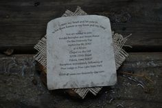 Our own handmade invites from cross cuts of a log, burlap and handmade paper.