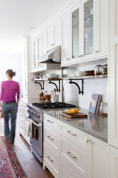 Install cabinets an extra foot up to add an open shelf to keep things off the counter (Reader's home - Nicole's kitchen renovation - desire to inspire - desiretoinspire.net  (LOVE the back splash tile)