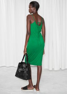 Model back image of Stories tie back dress in green