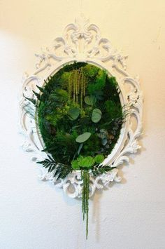 Plants on all the curves and edges in the mirror with flowers for bold statements