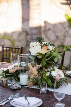Wedding Reception decor ideas,  drift wood and blooms centerpieces, wedding design by Bliss Los Cabos.