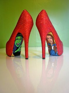 Ruby red (slippers) stilettos with Oz illustrations??? I am in love! And even tho I abhor wearing stilettos, I may make an exception for this. I will just sit and show off the shoes all night. :D
