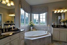 Double vanity with corner tub + windows