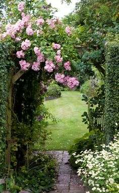 Future inviting  flower arch beckoning you to the back of our wrap around porch.  I absolutely LOVE this site! I thought my inspiration of ideas had withered.  Pinterest is an amazing outlet for creativity. <3