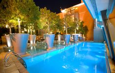 The five-star African Pride Melrose Arch Hotel is located in an exclusive development area in the north of Johannesburg within South Africa's bustling Gauteng province Michelangelo Hotel, Arch Hotel, Melrose Arch, Pool At Night, International Companies, Hotels, South Africa, Pride, Spa