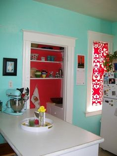 red pantry set into turquoise wall
